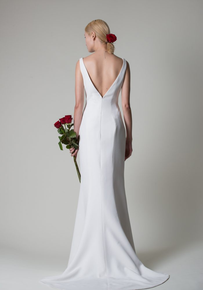 elegant wedding dress in soft ivory crepe.